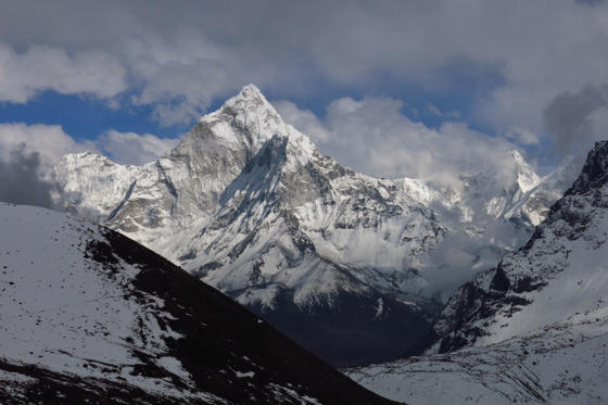 Mt Ama Dablam surrounded by clouds. Everest National Park, Nepal.