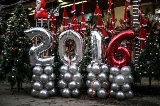 GAZA CITY, GAZA - DECEMBER 17: Balloons in the form 2016 are placed at a gift shop ahead of the new year in Gaza City, Gaza on December 17, 2015. (Photo by Ali Hassan/Anadolu Agency/Getty Images)