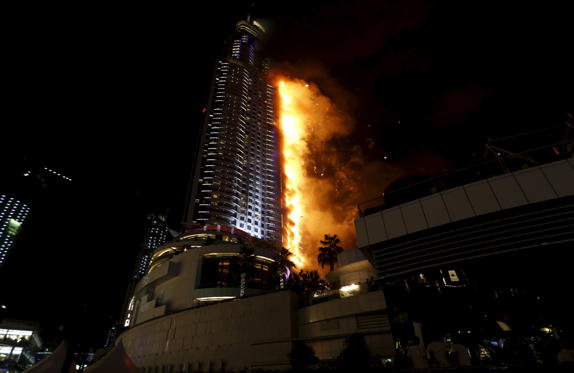 A fire engulfs The Address Hotel in downtown Dubai in the United Arab Emirates December 31, 2015. REUTERS/Ahmed