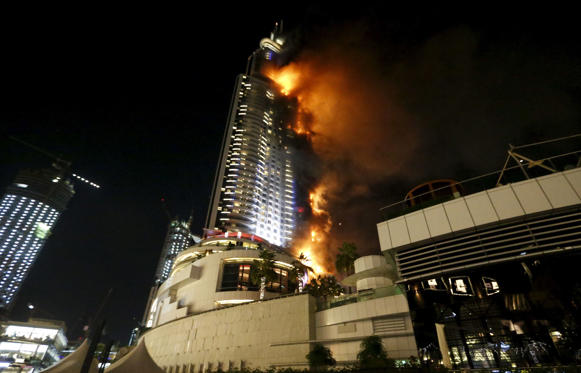 Massive fire engulfed a skyscraper in Dubai hours before the start of the New Year's eve celebrations.