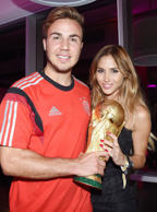 Germany football team celebrate winning the World Cup at the Sheraton Hotel, Rio de Janeiro, Brazil - 13 Jul 2014 Mario Gotze and Ann-Kathrin Brommel with the trophy
