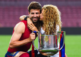 BARCELONA, SPAIN - MAY 30: Gerard Pique of FC Barcelona and Shakira pose with th...
