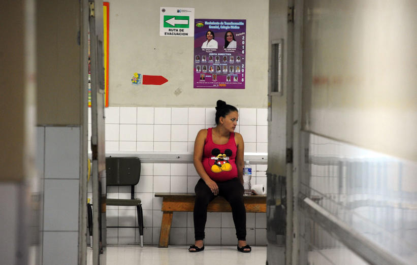 A pregnant woman waits to be attended at the Maternal and Children's Hospital in Tegucigalpa on January 21, 2016. The medical school at the National Autonomous University of Honduras (UNAH) recommended that women in the country avoid getting pregnant for the time being due to the presence of the Zika virus. If a pregnant woman is infected by the virus, the baby could be born with microcephaly. AFP PHOTO/Orlando SIERRA / AFP / ORLANDO SIERRA        (Photo credit should read ORLANDO SIERRA/AFP/Getty Images)
