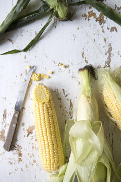 "<p>Yellow corn is full of—you guessed it—beta-carotene. In addition to giving you the <a href=""http://www.redbookmag.com/beauty/makeup-skincare/advice/g1776/good-skin-foods/?slide=2"">healthy glow</a> that a diet full of colorful veggies provides, yellow corn also <a href=""http://www.redbookmag.com/body/healthy-eating/g2869/high-sugar-food/"">has less sugar</a> than its counterpart white corn, allowing you to keep the <a href=""http://www.redbookmag.com/body/features/g2781/bad-foods-for-bikini-season/"">sugar-induced acne</a> on the DL.</p>"