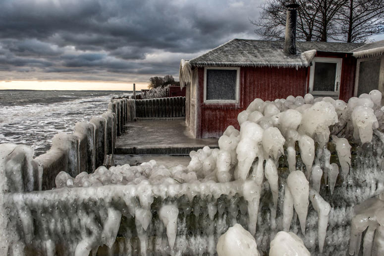 Ice formations are seen at the beach near Fakse Ladeplads, south of Copenhagen, Denmark, Tuesday Jan. 5. 2016. Daytime temperatures in the area were between zero and minus four degrees Celcius. (Per Rasmussen/Polfoto via AP) DENMARK OUT