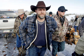 Ammon Bundy, center, one of the sons of Nevada rancher Cliven Bundy, arrives for...
