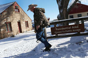 Lavoy Finicum walks through the compound as he and others occupy the Malheur National Wildlife Refuge headquarters on January 15, 2016 near Burns, Oregon.