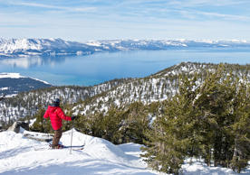 Skier looking at Lake Tahoe from the ski slope of Heavenly Mountain Resort, USA.