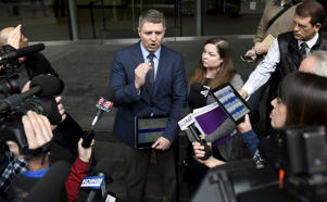 Michael Arnold (L) and Lissa Casey (R), attorneys representing Ammon Bundy address the media covering the hearing of militia members arrested from the occupation of Malheur National Wildlife Refuge outside United States District Court in Portland, Oregon January 27, 2016. U.S. authorities tightened security after their standoff with the occupiers turned violent on Tuesday when officers stopped a car and arrested occupation leader Ammon Bundy and his group near the refuge.