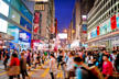 busy Street with blurred people and neon signs in Kowloon, Hong Kong