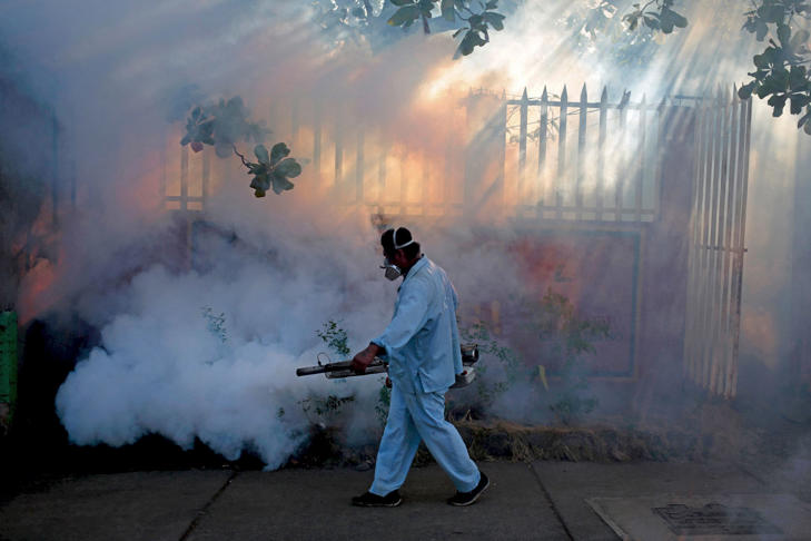 A health ministry worker fumigates a house to kill mosquitoes during a campaign against dengue and chikungunya and to prevent the entry of Zika virus in Managua, Nicaragua January 26, 2016. The Government of Nicaragua announced a plan in order to stop the Zika virus from arriving in the country.  Oswaldo Rivas/Reuters