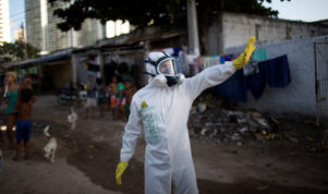 A municipal worker gestures during an operation to combat the Aedes aegypti mosquitoes that transmits the Zika virus in Recife, Pernambuco state, Brazil, Tuesday, Jan. 26, 2016. Brazil's health minister Marcelo Castro says the country is sending some 220,000 troops to battle the mosquito blamed for spreading a virus suspected of causing birth defects, but he also says the war is already being lost. Felipe Dana/AP