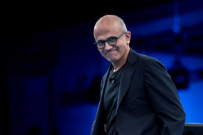 Satya Nadella, chief executive officer of Microsoft Corp., walks onto the stage ...