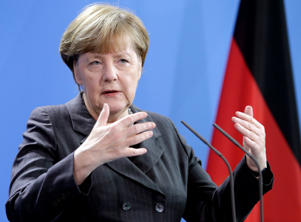 German Chancellor Angela Merkel gestures during a joint press conference with Prime Minister of Italy Matteo Renzi as part of a meeting at the chancellery in Berlin, Germany, Friday, Jan. 29, 2016.