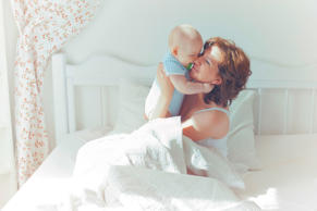 Baby and mom together in bedroom