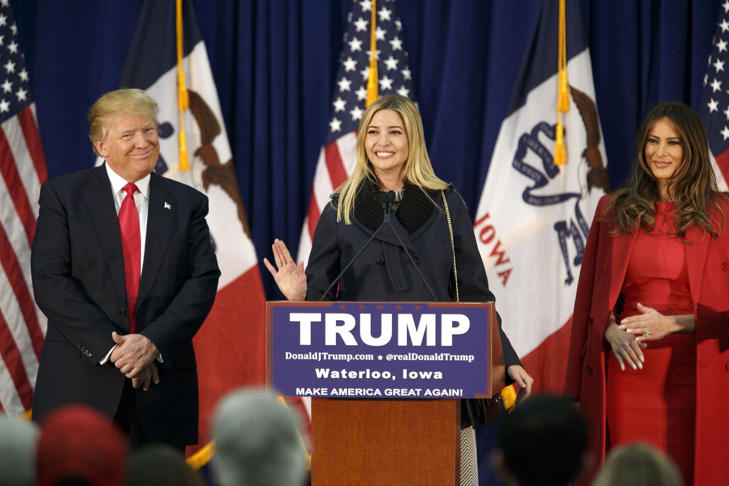 Donald Trump, president and chief executive of Trump Organization Inc. and 2016 Republican presidential candidate, left, and wife Melania Trump, right, smile as daughter Ivanka Trump speaks during a campaign event in Waterloo, Iowa, U.S., on Monday, Feb. 1, 2016. Patrick T. Fallon/Bloomberg