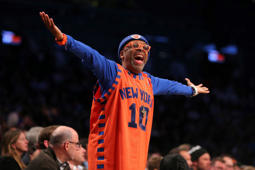 Actor and director Spike Lee argues with an official during the fourth quarter between the New York Knicks and the Brooklyn Nets on Wednesday at Barclays Center in Brooklyn. The Nets defeated the Knicks 110-104.