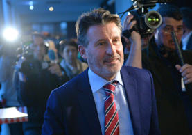 Camera teams follow IAAF-President Sebastian Coe after attending a press conference about WADA's Independent Commission Report in Munich, Germany, on Jan. 14, 2016. (AP Photo/Kerstin Joensson)