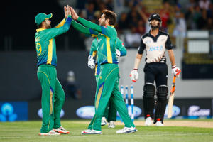 Shahid Afridi of Pakistan celebrates his wicket of Grant Elliott of New Zealand during the first T20 match