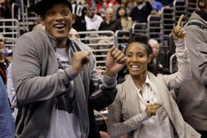 Philadelphia 76ers part owners Will Smith, left, and Jada Pinkett Smith dance during an NBA basketball game against the Miami Heat, Friday, March 16, 2012, in Philadelphia.