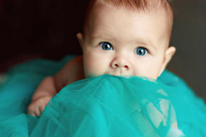 Baby with blue eyes.