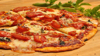 Delicious as it is, some Italian food isn't known for being healthy: pizza, pasta and risotto are all calorie-laden, carb-heavy dishes. Pizza is the worst offender – one medium pizza can easily use up half a person's daily calorie allowance.1 medium pizza: 1122 cals, 39g fat (generic recipe)