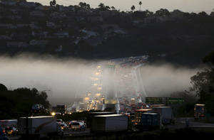 Morning commuter traffic travels through a section of ground fog following an El Nino-strengthened storm in Solana Beach, California, January 8, 2016.