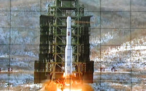 FILE - In this Dec. 12, 2012 file photo, a screen at the General Satellite Control and Command Center shows the moment North Korea's Unha-3 rocket is launched in Pyongyang, North Korea. North Korea said Monday, Sept. 14, 2015 it is ready to launch satellites aboard long-range rockets to mark a key national anniversary next month, a move expected to rekindle animosities with its rivals South Korea and the United States. North Korea has spent decades trying to perfect a multistage, long-range rocket. After several failures, it put its first satellite into space with a long-range rocket launched in late 2012.