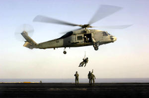 US Navy SEALs train with an SH-60F 'Seahawk' helicopter October 18, 2001 on the flight deck of USS Enterprise.