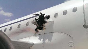 Explosion creates hole in Somali plane mid-air