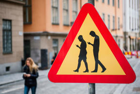 TOPSHOT - A road sign arning against pedestrians focusing on their smartphones is pictured on February 2, 2016 near the old town in Stockholm. / AFP / JONATHAN NACKSTRAND (Photo credit should read JONATHAN NACKSTRAND/AFP/Getty Images)