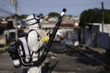 A municipal worker sprays insecticide at the neighborhood of Afogados in Recife, Brazil, February 2, 2016. The operation is part of the city's effort to prevent the spread of Zika's vector, the Aedes aegypti mosquito, according to a statement from Municipal Health Secretary.