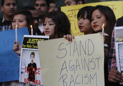 File: Members of North-Eastern state of India during a candle light vigil against racism and the beating and killing of student Nido Taniam at Jantar Mantar, on February 2, 2014 in New Delhi, India.