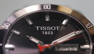 "A Tissot logo is seen on the ""PRS 516 Gent Auto"" watch displayed on the watchmaker's showcase at the Baselworld in Basel March 18, 2010."