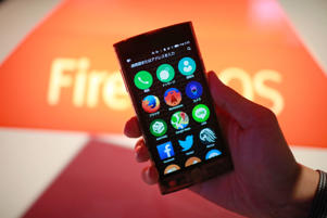 An employee shows the Firefox OS operating software on the screen of an LG Electronics Inc. Fx0 smartphone in the Firefox pavilion at the Mobile World Congress in Barcelona, Spain, on Tuesday, March 3, 2015.