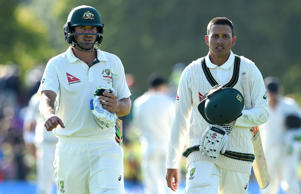 Joe Burns and Usman Khawaja, right, leave the field at stumps.