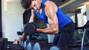 Gym workout - male athlete exercising in the gym.