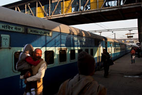 File: The shadows of disembarking Indian passengers are cast on a train coach as other passengers walk on the platform at the Hazrat Nizamuddin railway station in New Delhi on February 26, 2013, when the railway budget is due to be tabled in Parliament.