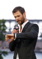 Chris Hemsworth speaks on stage at the launch of Heuer 01 at The Royal Botanic Gardens in Sydney.