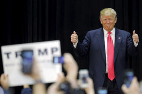 U.S. Republican presidential candidate Donald Trump gives two thumbs up as he takes the stage for a campaign rally in Portsmouth, New Hampshire, February 4, 2016.