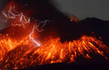 Volcanic lightning is seen at an eruption of Mount Sakurajima, in this photo taken from Tarumizu city, Kagoshima prefecture, southwestern Japan, in this photo taken by Kyodo February 5, 2016. A Japanese volcano about 50 km (30 miles) from a nuclear plant erupted on Friday, Japan's Meteorological Agency said, sending fountains of lava into the night sky.