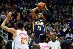 Indiana Pacers forward Paul George (13) shoots the ball against the Atlanta Hawk...