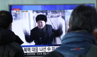 "South Koreans watch a TV news program showing North Korean leader Kim Jong Un, at Seoul Railway Station in Seoul, South Korea, Wednesday, Feb. 3, 2016. South Korea warned on Wednesday of ""searing"" consequences if North Korea doesn't abandon plans to launch a long-range rocket that critics call a banned test of ballistic missile technology. The headline reads ""North Korea's nuclear."""