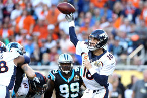 Denver Broncos quarterback Peyton Manning throws a pass against the Carolina Pan...