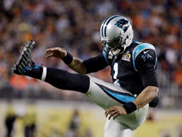 Carolina Panthers' Cam Newton (1) kicks his leg during the second half.