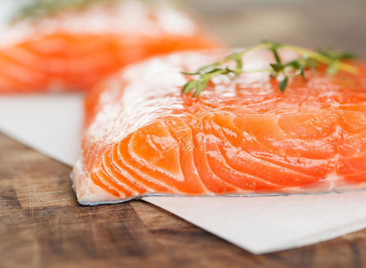 "<p>Fatty fish like wild <a href=""http://www.eatthis.com/shocking-facts-about-farmed-salmon"">salmon</a> contain omega-3 fatty acids that help reduce inflammation, slow the plaque buildup inside blood vessels and increase the ratio of good to bad cholesterol levels, explains Koszyk. ""They've also been shown to lower blood pressure, ddiecreasing the odds of stroke and heart failure."" Wondering how much to eat? An analysis of 20 studies published in the journal JAMA indicates that eating one to two 3-ounce servings of fatty fish a week reduces the risk of dying from heart disease by an impressive 36 percent! If you're already suffering from heart disease Koszyk recommends upping your intake to three 4-ounce servings throughout the week. ""In addition to the fish, taking three 1000 mg omega-3 vitamins containing EPA and DHA daily is recommended for those with heart disease. Don't take them all at once, though. Take one in the morning, one at lunch, and one in the evening."" And be sure to bookmark, pin, print, and save our in-depth, exclusive report on <a href=""http://www.eatthis.com/fish"">40+ Popular Types of Fish—Ranked for Nutrition</a>.</p>"