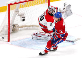 Feb 7, 2016; Montreal, Quebec, CAN; Montreal Canadiens right wing Sven Andrighetto (42) scores a goal against Carolina Hurricanes goalie Cam Ward (30) during a shootout at Bell Centre.