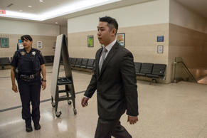 New York City Police officer (NYPD) Peter Liang arrives at Brooklyn Supreme Court for a pre-trial hearing, for the fatal shooting of an unarmed man while patrolling the stairwell of a Brooklyn housing project, in Brooklyn borough of New York May 14, 2015.