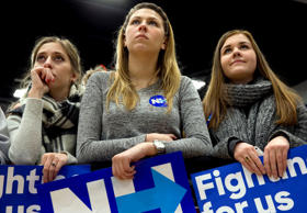 Young women listen to Democratic presidential candidate Hillary Clinton as she s...