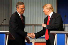 Republican presidential candidates Jeb Bush and Donald Trump shake hands after a presidential debate on Nov. 10, 2015, in Milwaukee.
